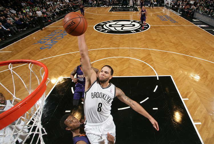 Deron had a big night, including his first dunk of the season, to lead the Nets over the Suns (Getty Images).