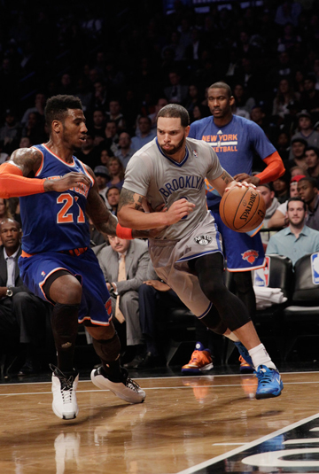 D-Will drives past New York's Iman Shumpert (Getty Images).