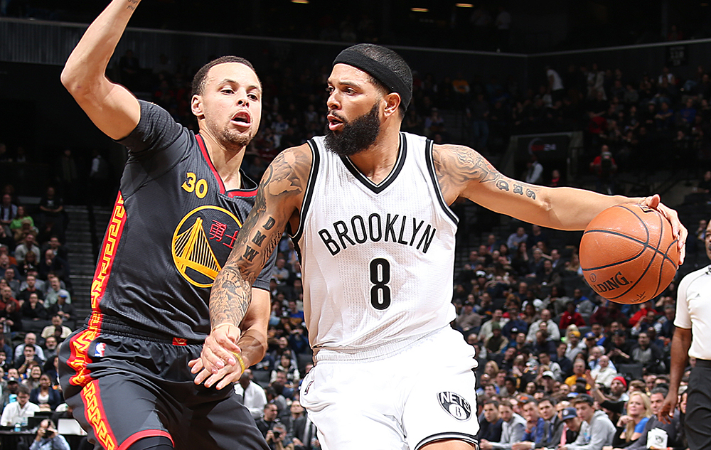 BROOKLYN, NY - MARCH 2:  Deron Williams #8 of the Brooklyn Nets handles the ball against Stephen Curry #30 of the Golden State Warriors during the game on March 2, 2015 at Barclays Center in Brooklyn, New York. NOTE TO USER: User expressly acknowledges and agrees that, by downloading and or using this Photograph, user is consenting to the terms and conditions of the Getty Images License Agreement. Mandatory Copyright Notice: Copyright 2015 NBAE (Photo by Nathaniel S. Butler/NBAE via Getty Images)