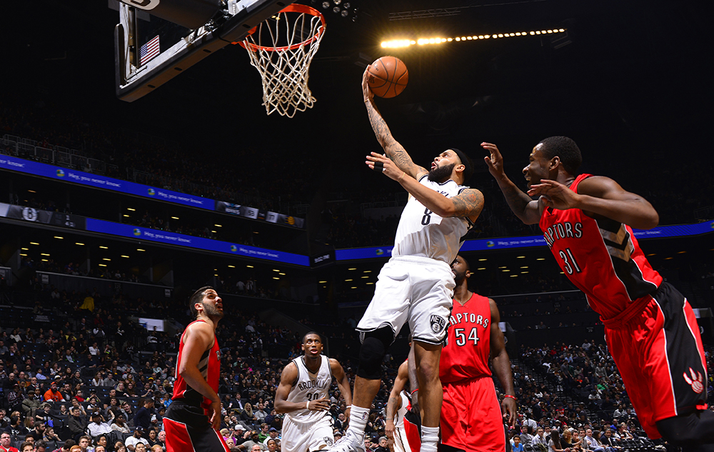 BROOKLYN,NY - APRIL 3: Deron Williams #8 of the Brooklyn Nets goes up for the layup against the Toronto Raptors at Barclays Center on April 3, 2015 in Brooklyn, New York NOTE TO USER: User expressly acknowledges and agrees that, by downloading and/or using this Photograph, user is consenting to the terms and conditions of the Getty Images License Agreement. Mandatory Copyright Notice: Copyright 2015 NBAE (Photo by David Dow/NBAE via Getty Images)