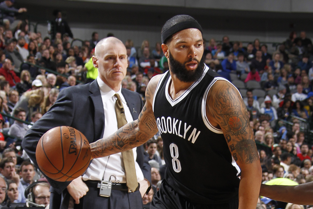 DALLAS, TX - FEBRUARY 28: Deron Williams #8 of the Brooklyn Nets handles the ball against Al-Farouq Aminu #7 of the Dallas Mavericks on February 28, 2015 at the American Airlines Center in Dallas, Texas. NOTE TO USER: User expressly acknowledges and agrees that, by downloading and or using this photograph, User is consenting to the terms and conditions of the Getty Images License Agreement. Mandatory Copyright Notice: Copyright 2015 NBAE (Photo by Danny Bollinger/NBAE via Getty Images)