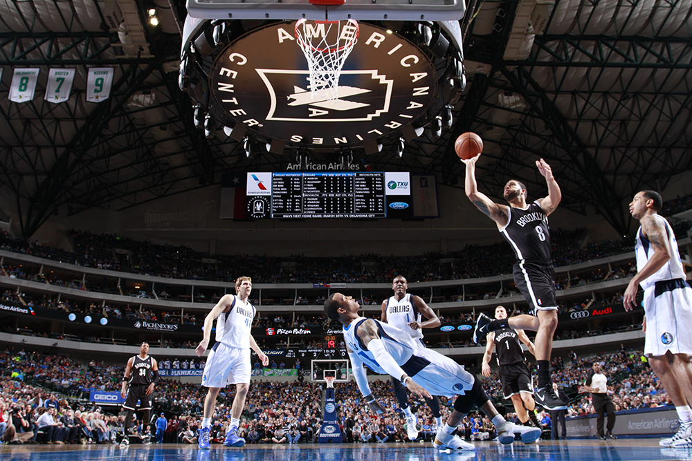DALLAS, TX - MARCH 23: Deron Williams #8 of the Brooklyn Nets shoots against the Dallas Mavericks on March 23, 2014 at the American Airlines Center in Dallas, Texas. NOTE TO USER: User expressly acknowledges and agrees that, by downloading and or using this photograph, User is consenting to the terms and conditions of the Getty Images License Agreement. Mandatory Copyright Notice: Copyright 2014 NBAE (Photo by Danny Bollinger/NBAE via Getty Images)