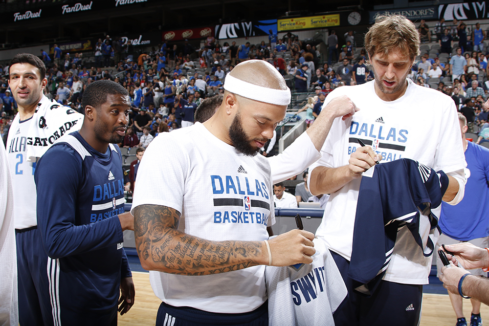 "DALLAS, TX - OCTOBER 4:  Deron Williams #8 and Dirk Nowitzki #41 of the Dallas Mavericks autograph items before throwing them to fans in attendance during the Dallas Mavericks ""Fan Jam"" on October 4, 2015 at the American Airlines Center in Dallas, Texas. NOTE TO USER: User expressly acknowledges and agrees that, by downloading and/or using this Photograph, user is consenting to the terms and conditions of the Getty Images License Agreement. Mandatory Copyright Notice: Copyright 2015 NBAE (Photo by Glenn James/NBAE via Getty Images)"