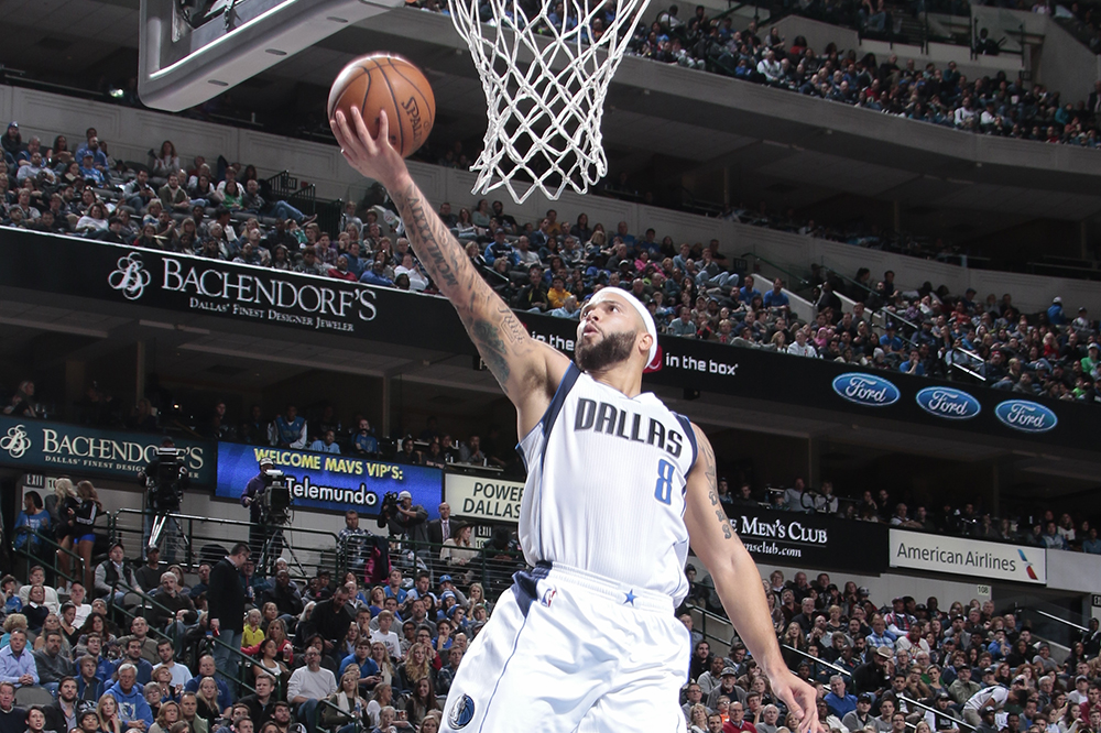 DALLAS, TX - NOVEMBER 28: Deron Williams #8 of the Dallas Mavericks goes in for the lay up against the Denver Nuggets on November 28, 2015 at the American Airlines Center in Dallas, Texas. NOTE TO USER: User expressly acknowledges and agrees that, by downloading and or using this photograph, User is consenting to the terms and conditions of the Getty Images License Agreement. Mandatory Copyright Notice: Copyright 2015 NBAE (Photo by Danny Bollinger/NBAE via Getty Images)